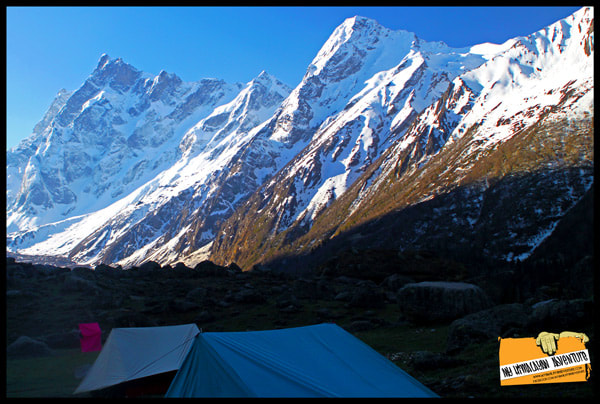 Camping at Har Ki Doon with Mt Swargarohini in the background